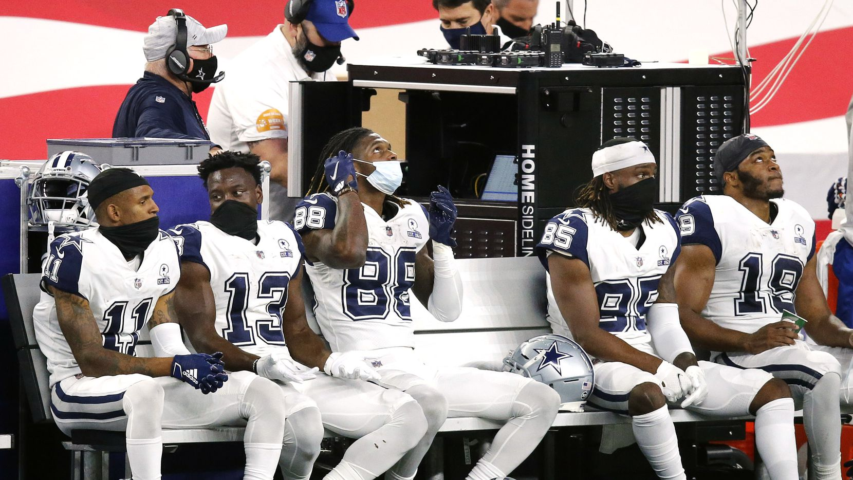 The Dallas Cowboys receiving corps of Ced Wilson (11), Michael Gallup (13), CeeDee Lamb (88), Noah Brown (85) and Amari Cooper (19) don their masks on the bench during the fourth quarter at AT&T Stadium in Arlington, Thursday, November 26, 2020. The Cowboys lost to the Washington Football Team, 41-16.