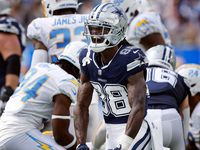 Dallas Cowboys wide receiver CeeDee Lamb (88) celebrates after his big first quarter catch to set up the Zeke touchdown run against the Los Angeles Chargers at SoFi Stadium in Inglewood, California, Sunday, September 19, 2021. (Tom Fox/The Dallas Morning News)