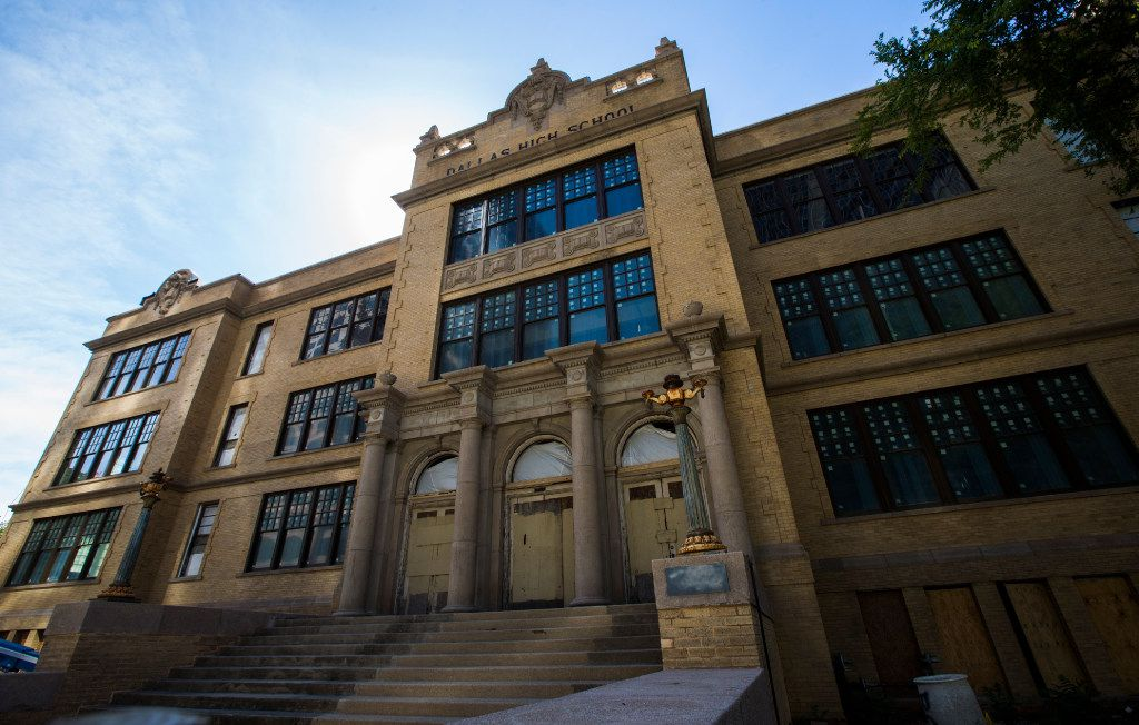 The north entrance of the old Dallas High School building, right, on Thursday, July 27, 2017 on Bryan Street in downtown Dallas. The 108-year-old building is being converted in to office space. (Ashley Landis/The Dallas Morning News)