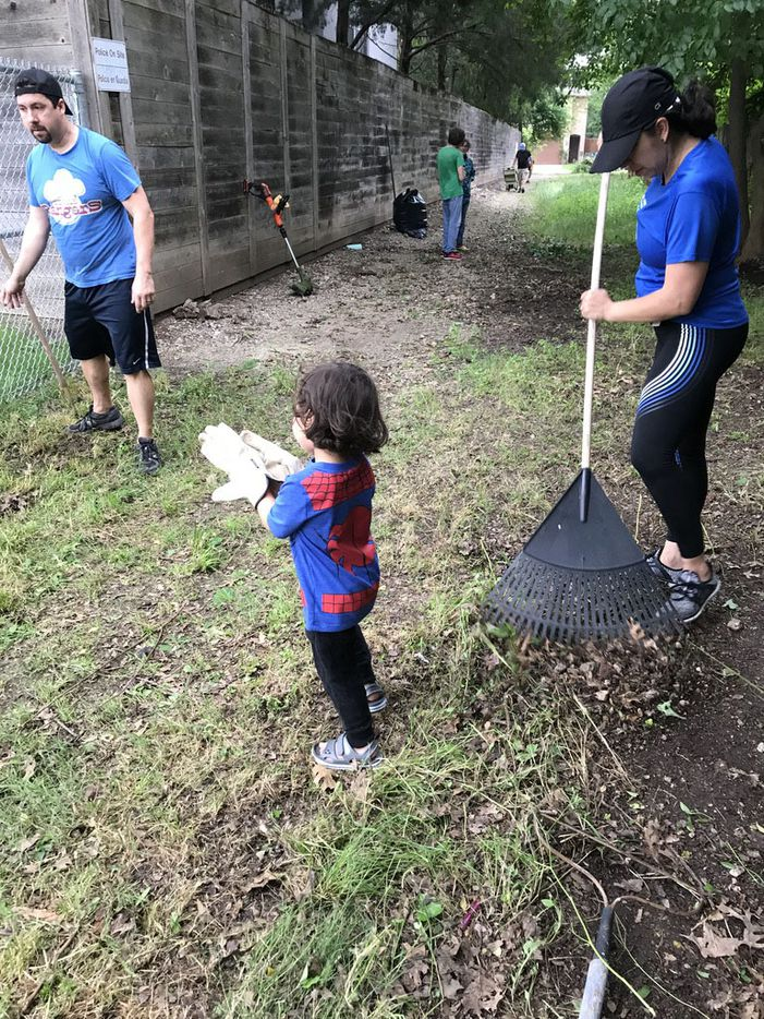 During workdays in May 2019, grownups and kids pitched in to try to clean out as much litter, debris, and unwanted vegetation as possible.