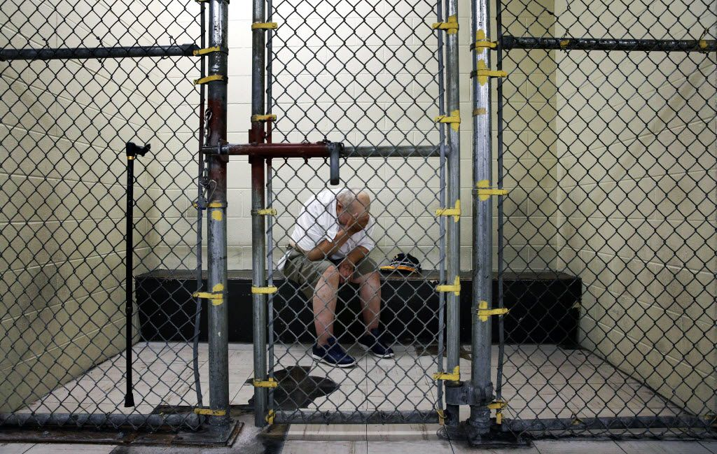 A U.S. veteran with post-traumatic stress sits in a segregated holding pen at the Cook County Jail after he was arrested on a narcotics charge in Chicago. The Chicago complex, with more than 10,600 inmates, is one of the country's largest single-site jails. From big cities to rural counties, the nation'€™s 3,300 local jails have turned into treatment centers of last resort for people with serious mental illnesses, most arrested for non-violent crimes.
