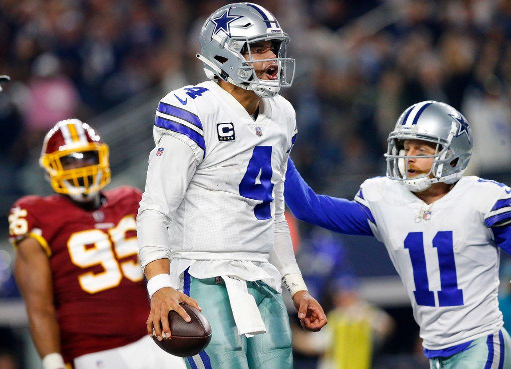 Dallas Cowboys quarterback Dak Prescott (4) celebrates his fourth quarter touchdown run against the Washington Redskins defense at AT&T Stadium in Arlington, Texas, Thursday, November 22, 2018. The Cowboys defeated the Redskins, 31-23. (Tom Fox/The Dallas Morning News)