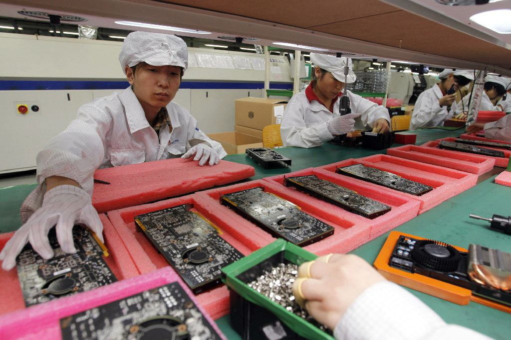 """Staff members work on the production line at the Foxconn complex in the southern Chinese city of Shenzhen, Southern city in China. Wisconsin Gov. Scott Walker says President Donald Trump plans to make a """"major jobs announcement for Wisconsin"""" as anticipation builds it will be about electronics giant Foxconn locating in the state."""