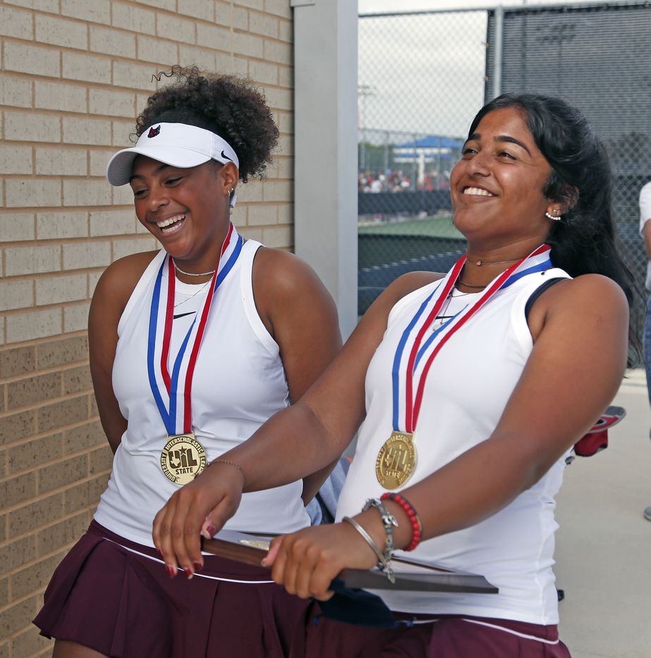Saundarya Vedula (right) and Tamiya Lintz after they won the 5A girls doubles match at the UIL State Tennis finals at Northside Tennis on Friday, May 21, 2021.
