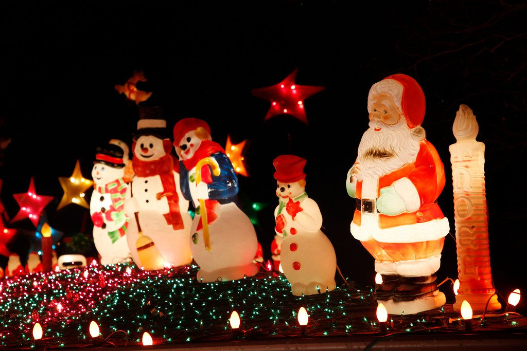 Snowmen congregate with Santa atop Simmons' home in Old East Dallas.