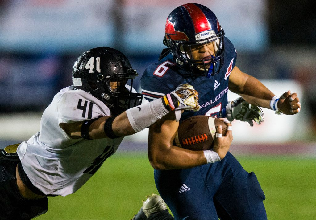 Bishop Dunne running back Jaden Hullaby (6) is brought down by Bishop Lynch's Plae Wyatt during the TAPPS Division I state championship game on December 7, 2018. (Ashley Landis/The Dallas Morning News)