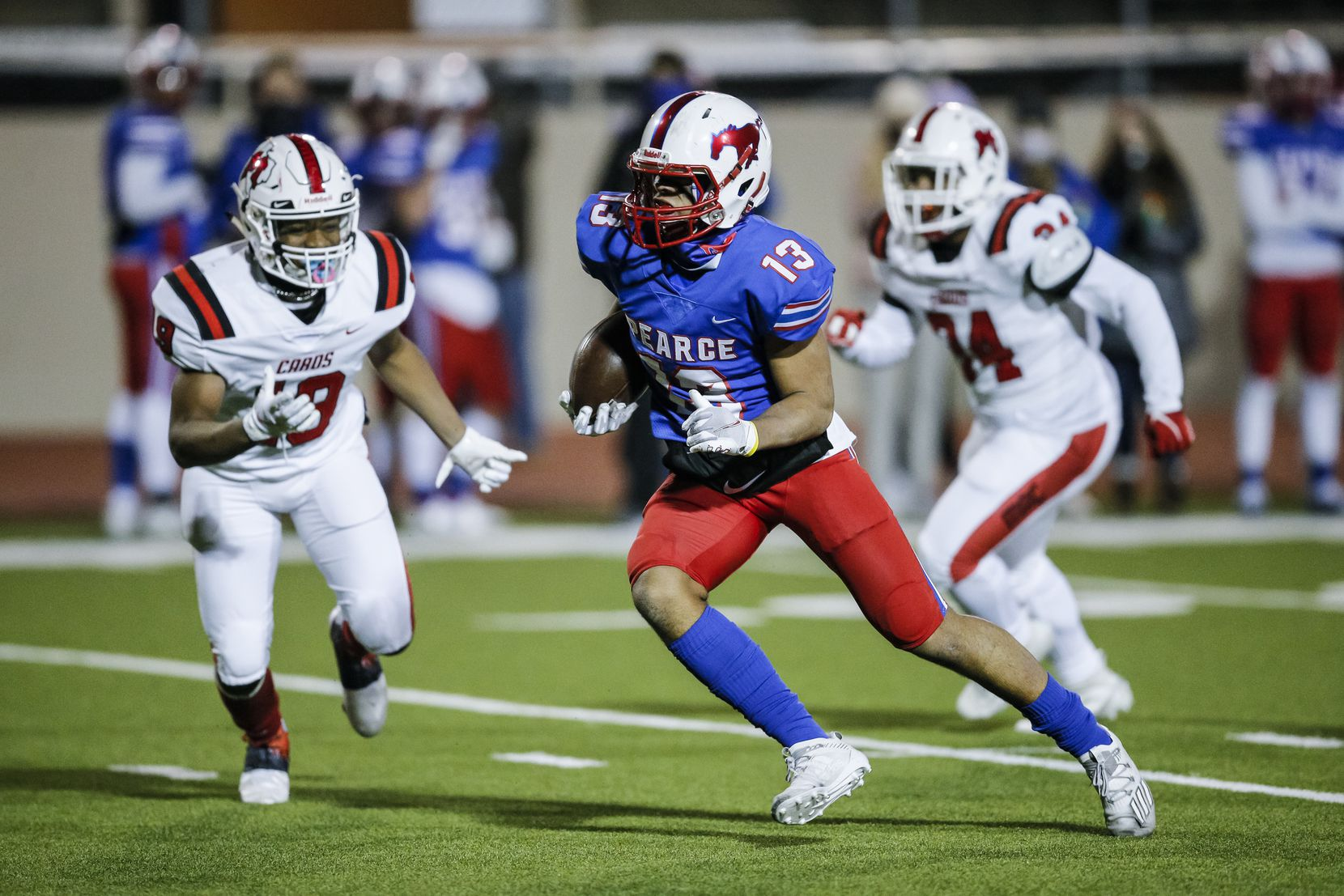 JJ Pearce junior wide receiver Oliver Crawford (13) carries the ball during the first half of a high school playoff football game against Irving MacArthur at Eagle-Mustang Stadium in Richardson, Thursday, December 3, 2020. (Brandon Wade/Special Contributor)
