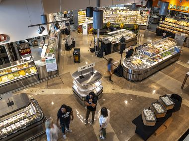 Employees prepare the Central Market at Preston Road and Royal Lane for its grand opening on Wednesday.