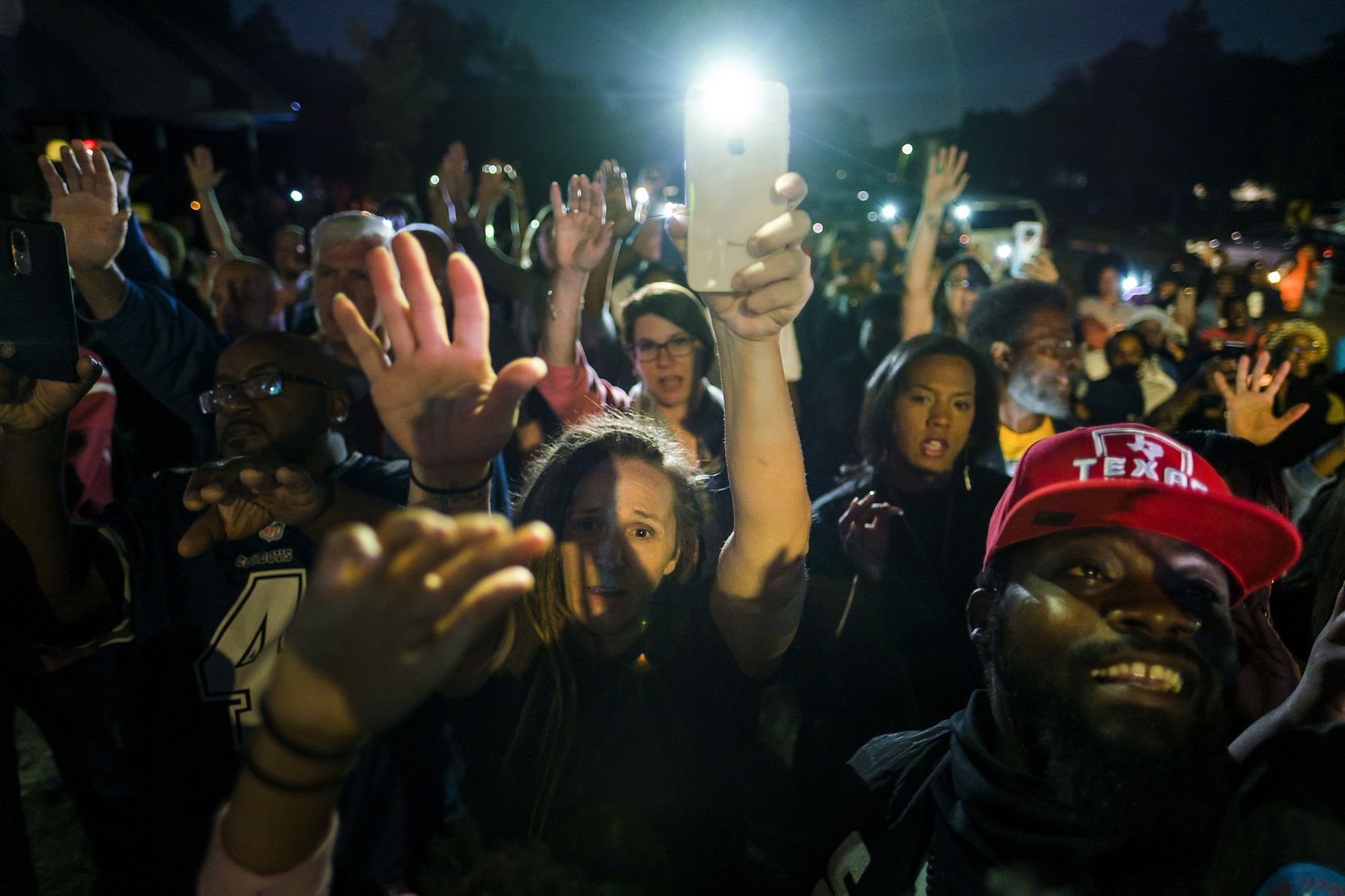 A large crowd gathers outside the house where Atatiana Jefferson was shot and killed, during a community vigil for Jefferson on Sunday, Oct. 13, 2019, in Fort Worth.