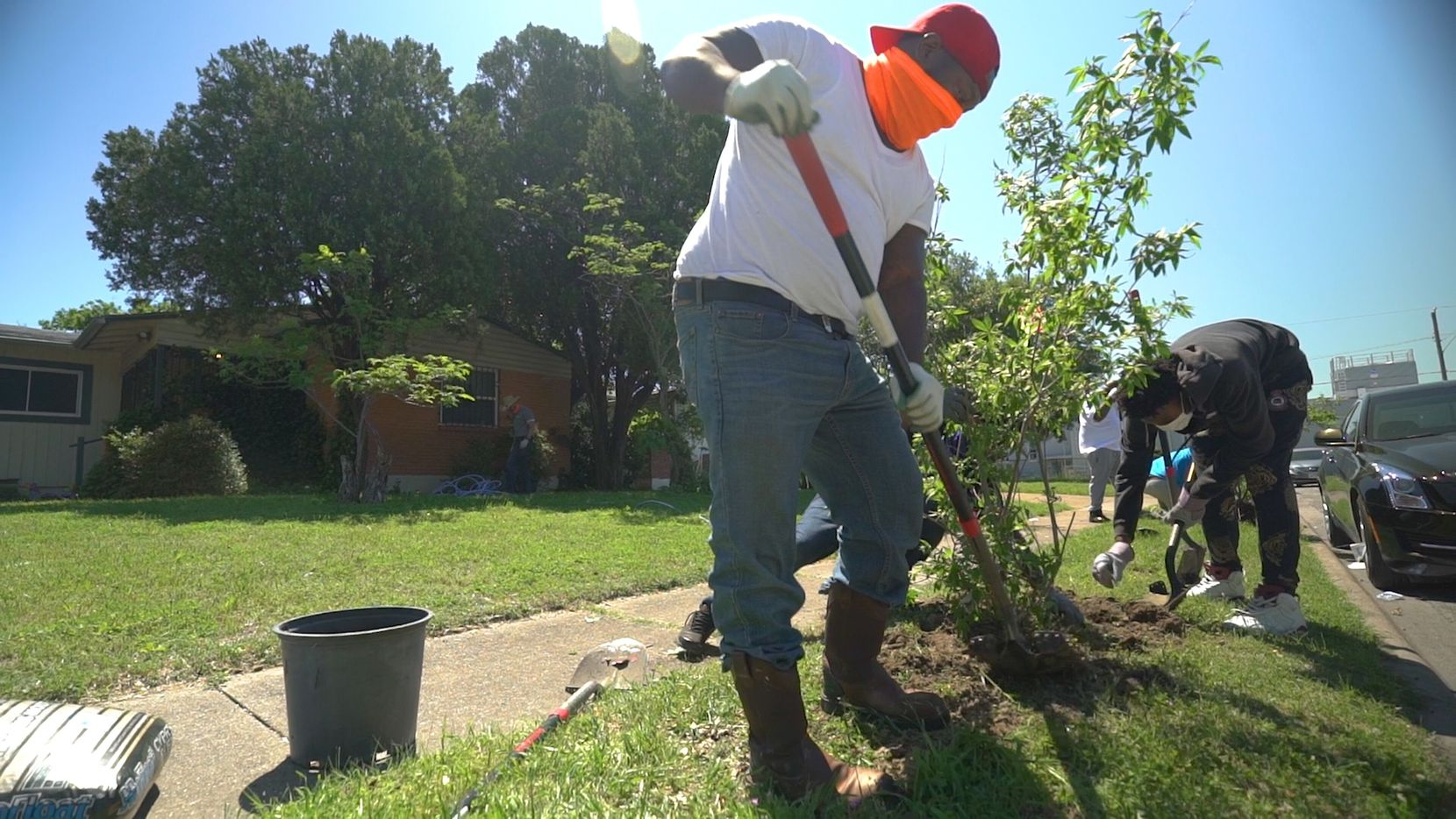 A worker plants a sapling as part of a past Texas Tree Foundation planting event. The nonprofit will donate trees to eligible Dallas residents on April 10.