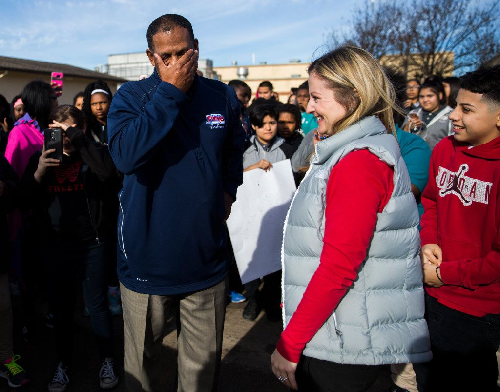 Coach Kevin MaBone reacts as principal Leslie Feinglas surprises him with a car during a presentation by students and teachers on Friday outside Wilkinson Middle School in Mesquit. MaBone was diagnosed with cancer, and had to rely on teachers to get to and from work and to cancer treatments. The school raised money to buy a car and gift it to MaBone.
