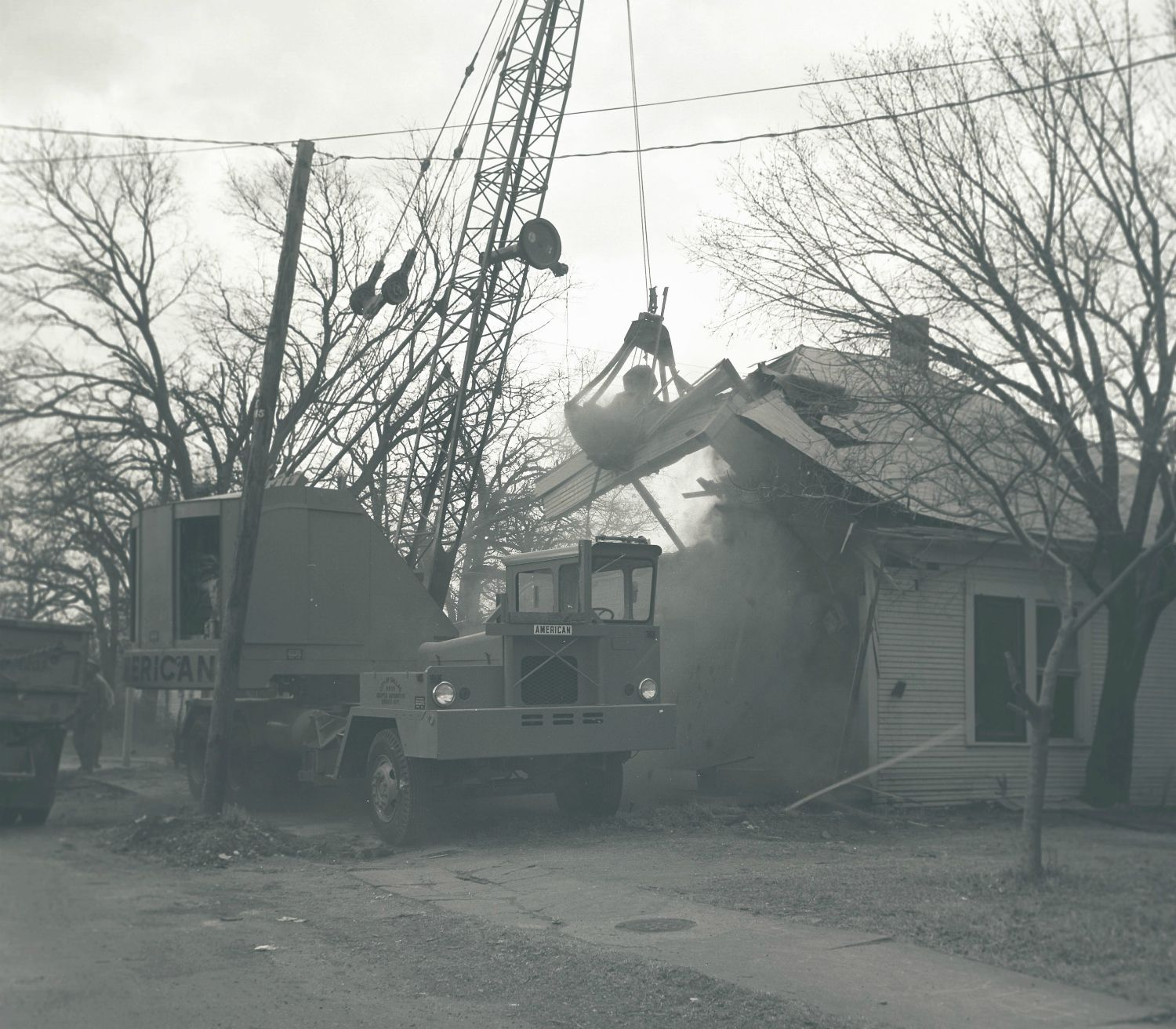 A wrecking crew goes to work demolishing a Fair Park house in the 1960s, to make way for a parking lot now locked off from the adjacent neighborhoods.