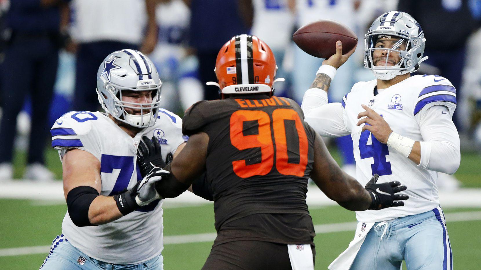 Dallas Cowboys offensive guard Zack Martin (70) blocks Cleveland Browns defensive tackle Jordan Elliott (90) so quarterback Dak Prescott (4) can get off a throw during the fourth quarter at AT&T Stadium in Arlington, Texas, Sunday, October 4, 2020.