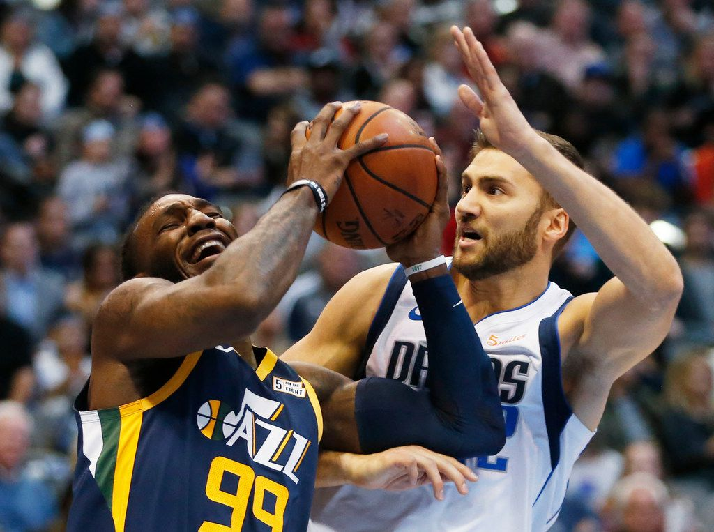 Utah Jazz forward Jae Crowder (99) drives to the basket as he is defended by Dallas Mavericks forward Maximilian Kleber (42) during the first half of play at American Airlines Center in Dallas on Wednesday, November 14, 2018. (Vernon Bryant/The Dallas Morning News)