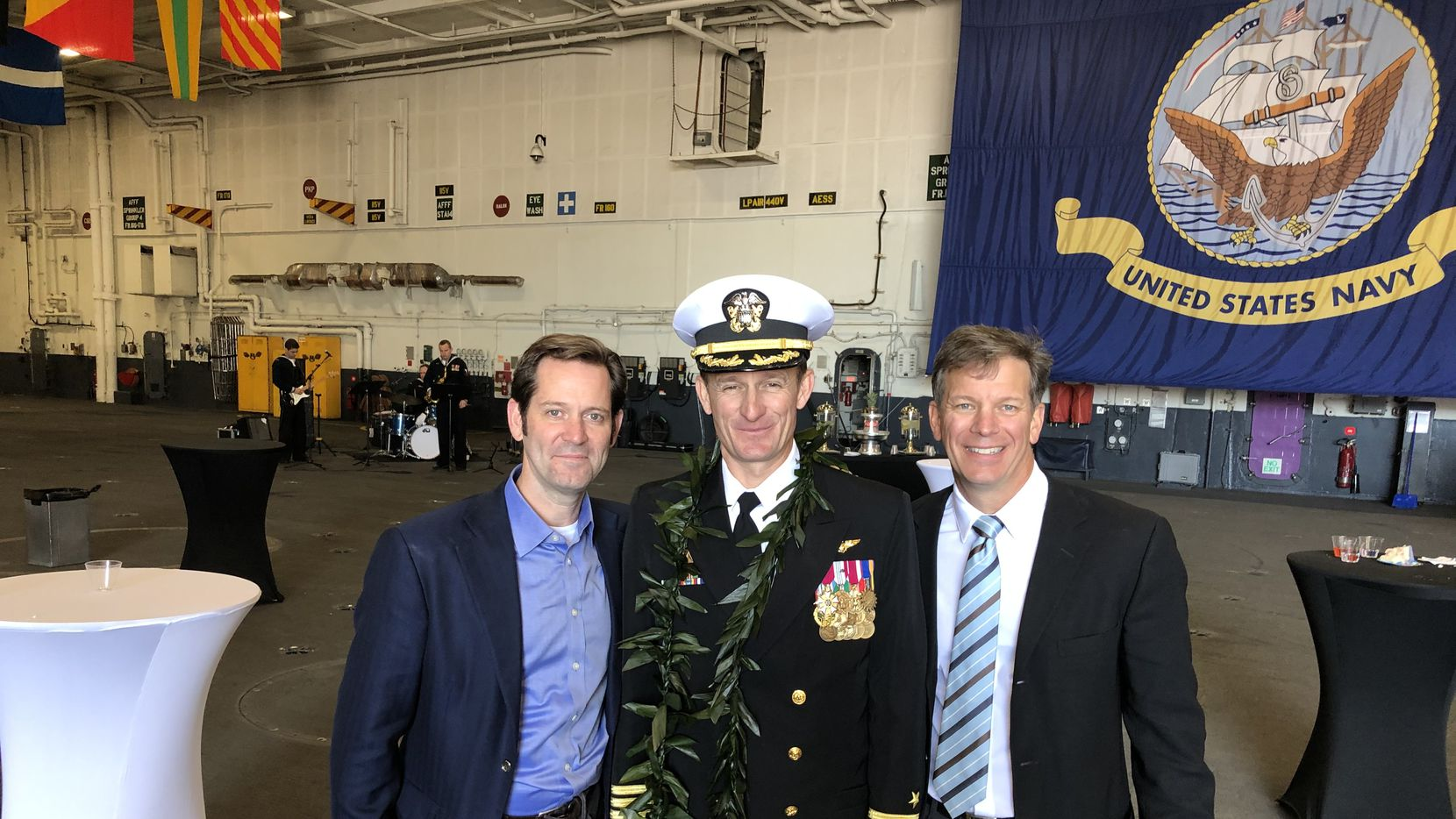 Captain Brett Crozier (center) with Naval Academy classmates Brett Odom (left) and Mark Roppolo (right) on Nov. 1, 2019, after Crozier took command of the USS Theodore Roosevelt.
