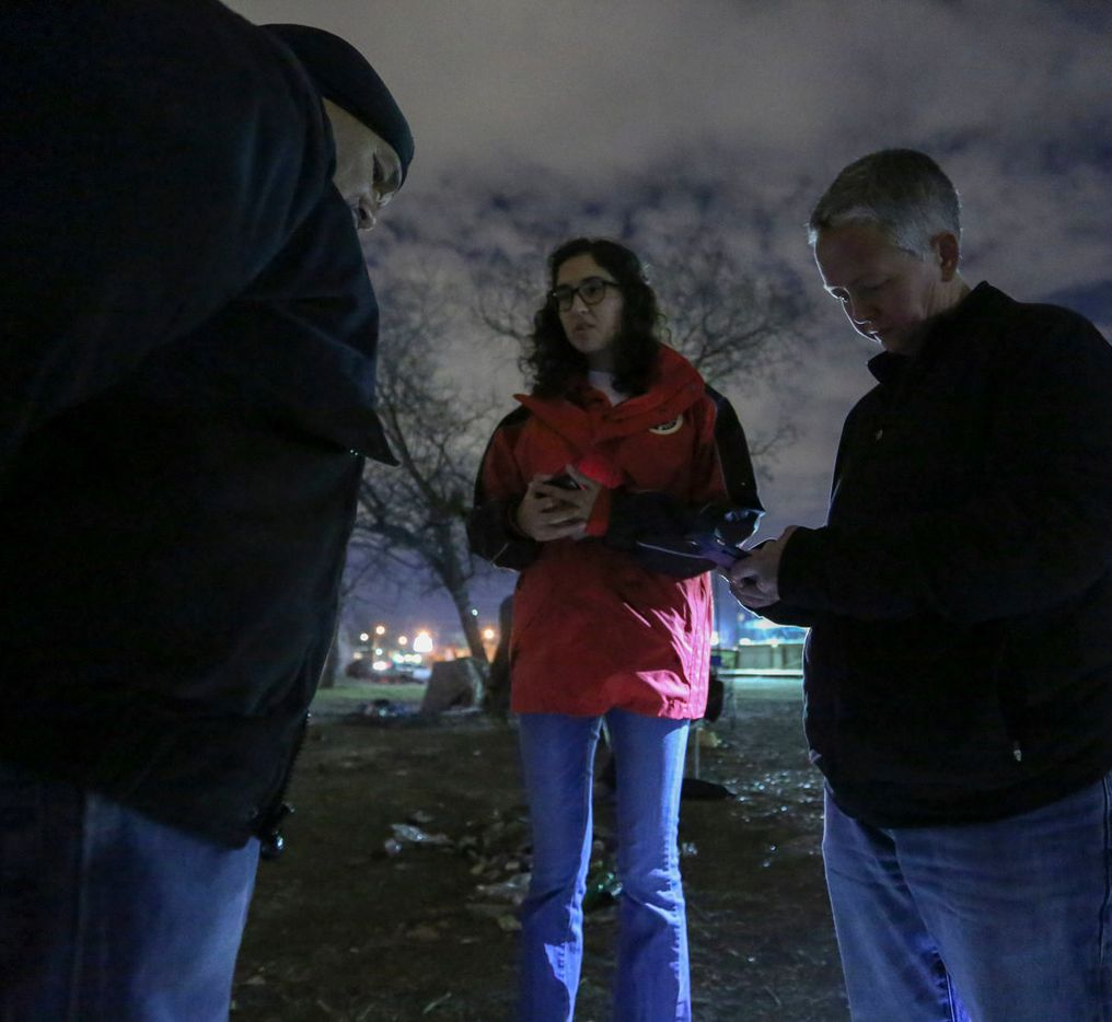 A homeless man who identified himself as Tony is interviewed by Ali Witt and Catherine Imes, volunteers with the Metro Dallas Homeless Alliance.