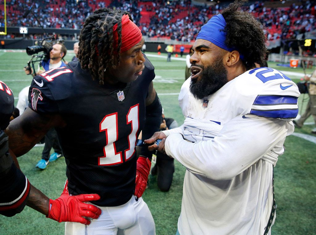 Dallas Cowboys running back Ezekiel Elliott (21) and Atlanta Falcons wide receiver Julio Jones (11) visit after the game at Mercedes-Benz Stadium in Atlanta, Sunday, November 18, 2018. The Cowboys pulled out a 22-19 win. (Tom Fox/The Dallas Morning News) ORG XMIT: DMN1811181644270646
