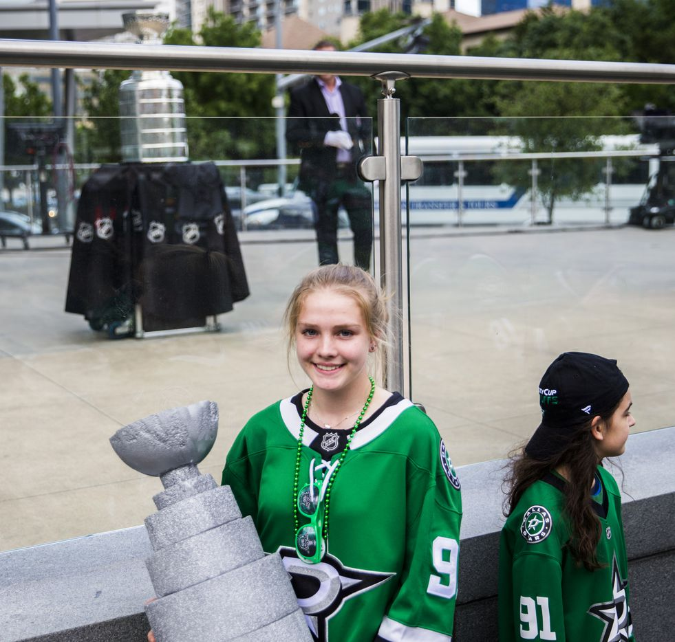 Megan Filippo holds a model that she made of the Stanley Cup while posing for a photo with the real one outside American Airlines Center before Game 6 of the first round of the Stanley Cup playoffs between the Stars and Nashville Predators.