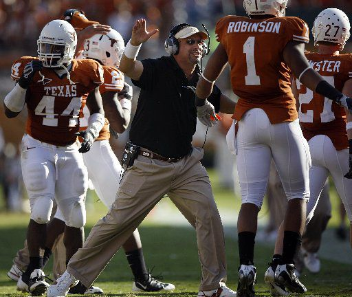 FILE - Texas receivers coach Bobby Kennedy congratulates his players hard work after a touchdown against Oklahoma State at Darrell K Royal Memorial Stadium, Saturday, October 25, 2008.
