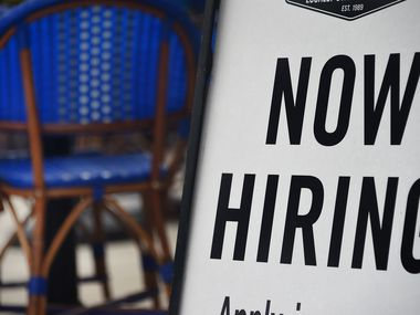 "A Virginia restaurant displays a ""Now Hiring"" sign, a reflection of growing demand for food service workers. In June, the food and lodging industry had 719,000 job openings, according to federal data."