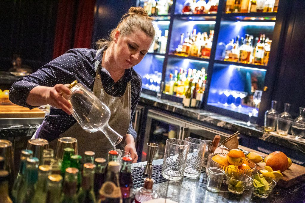 Bartender Angela Burns makes a cocktail at The French Room in Dallas on Jan. 19, 2019.