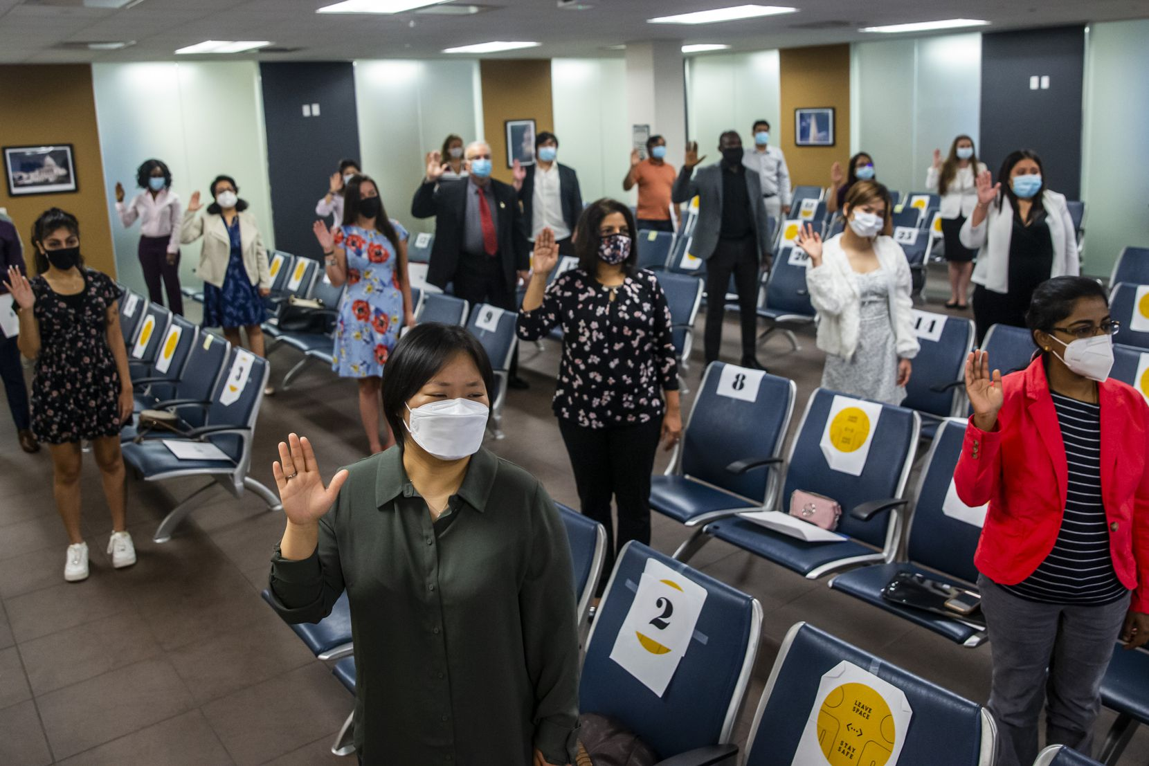 Rebecca Taehee Lee (front) joined others in taking an oath of citizenship during a socially-distanced naturalization ceremony virtually presided over by Chief Judge Barbara Lynn at the United States Citizenship and Immigration Services Field Office in Irving on Friday, Sep. 18, 2020.