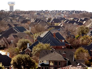 A McKinney water tower rises in the background over a sea of suburban rooftops of subdivisions in McKinney. The students of Reuben Johnson Elementary School will be learning from home for the rest of the year with 1/3 of the school's staff sidelined by COVID-19.