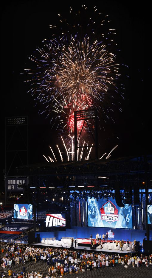 Fireworks explode over the main stage after the completion of the Class of 2021 enshrinement ceremony at Tom Benson Hall of Fame Stadium in Canton, Ohio, Sunday, August 8, 2021. (Tom Fox/The Dallas Morning News)