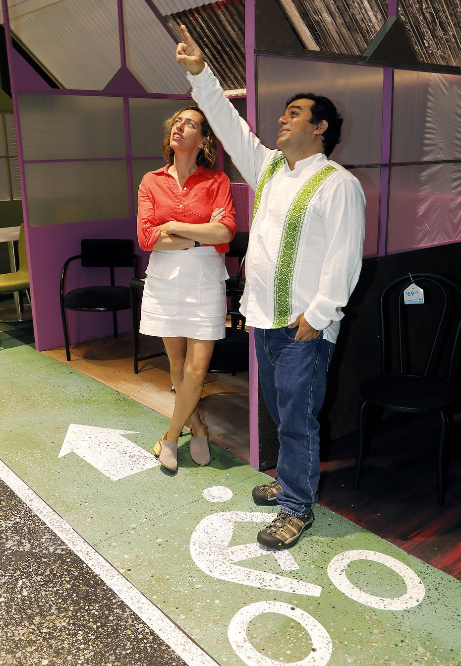 David Lozano, right, points out lighting details to Sara Cardona in the new black box theater at the Latino Cultural Center. Their groups, Cara Mia Theatre and Teatro Dallas, begin using the space this month.