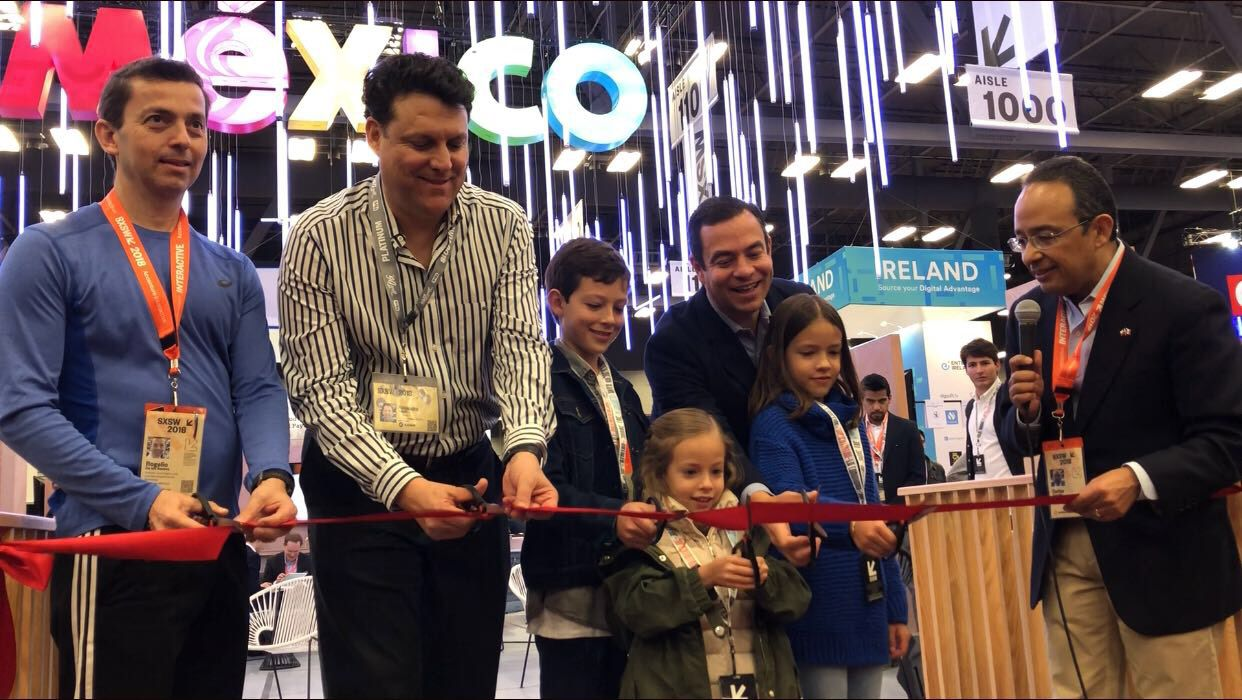 Mexican officials and their children inaugurate the opening of Mexico's pavilion at the South by Southwest Trade Show in Austin this week. From left: Rogelio De los Santos, head of the Institute of Business at Tec de Monterrey; Alejandro Delgado, president of the National Institute of Entrepreneurship; Paulo Carreno, CEO of ProMexico; and Carlos Gonzalez Gutierrez, consul general of Mexico in Austin.