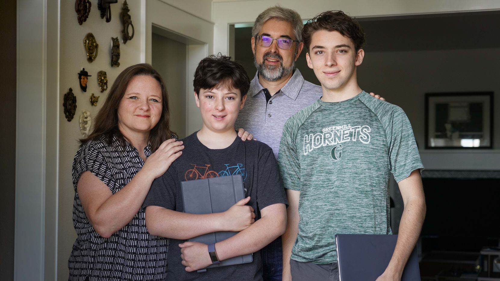 Rebekah and Ben Newman (left and back) with their sons Miles, 12 (center), and Ethan, 18 (right), photographed at their home on Tuesday, June 16, 2020, in Dallas. (Smiley N. Pool/The Dallas Morning News)