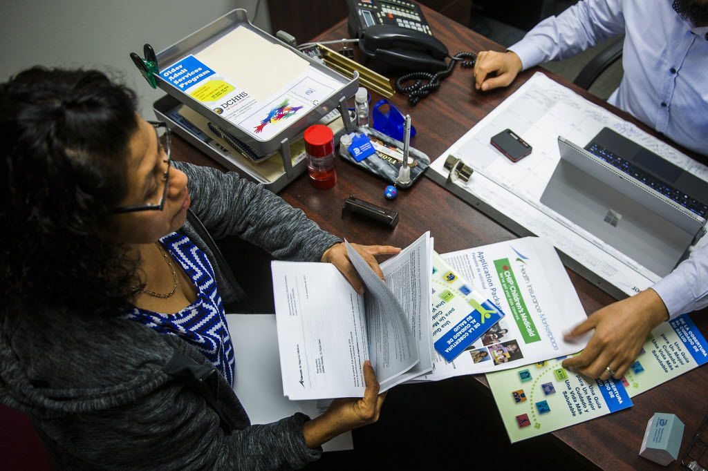 Client Rosa Sanchez works with Affordable Care Act navigator Able Serna at Community Council of Greater Dallas on Friday, Nov. 13, 2015, in Dallas.  Open enrollment has started for the third year of the health insurance marketplace in Texas and premiums have increased in Dallas-Fort Worth by just 3.9 percent, using the second-lowest-cost silver plan as a benchmark, according to federal officials. (Smiley N. Pool/The Dallas Morning News)