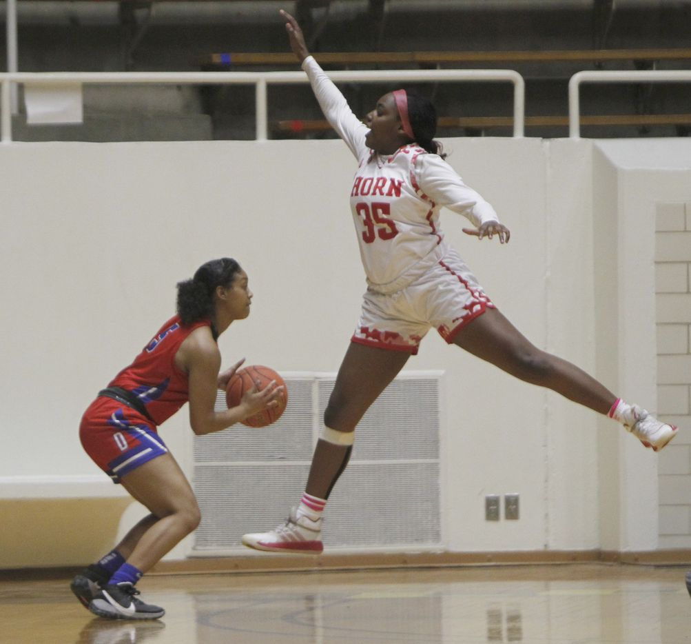 Mesquite Horn guard Viencia Jackson (35) leaps defensively as Duncanville guard Kiyara Howard-Garza (5) sizes up a shot during first half action. The two teams played their Class 6A area-round playoff basketball game at Loos Field House in Addison on February 23, 2021. (Steve Hamm/ Special Contributor)