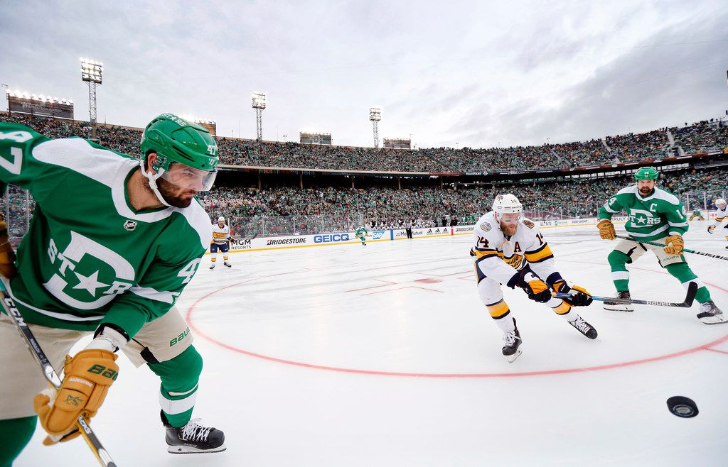 Dallas Stars right wing Alexander Radulov (47) waits on the puck as Nashville Predators defenseman Mattias Ekholm (14) tries to clear it during the third period of the NHL Winter Classic hockey game at the Cotton Bowl in Dallas, Wednesday, January 1, 2020. The Stars came back to win, 4-2. (Tom Fox/The Dallas Morning News)