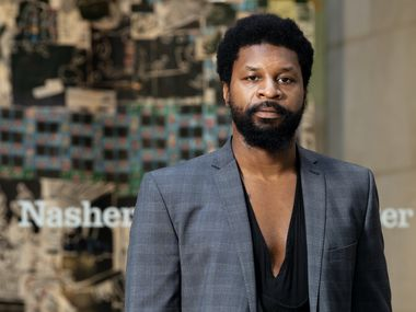 "Artist XXavier Carter, standing near the Flora Street entrance of the Nasher Sculpture Center, where his exhibition, ""Nasher Windows: XXavier Edward Carter,"" opened on May 29, 2020."
