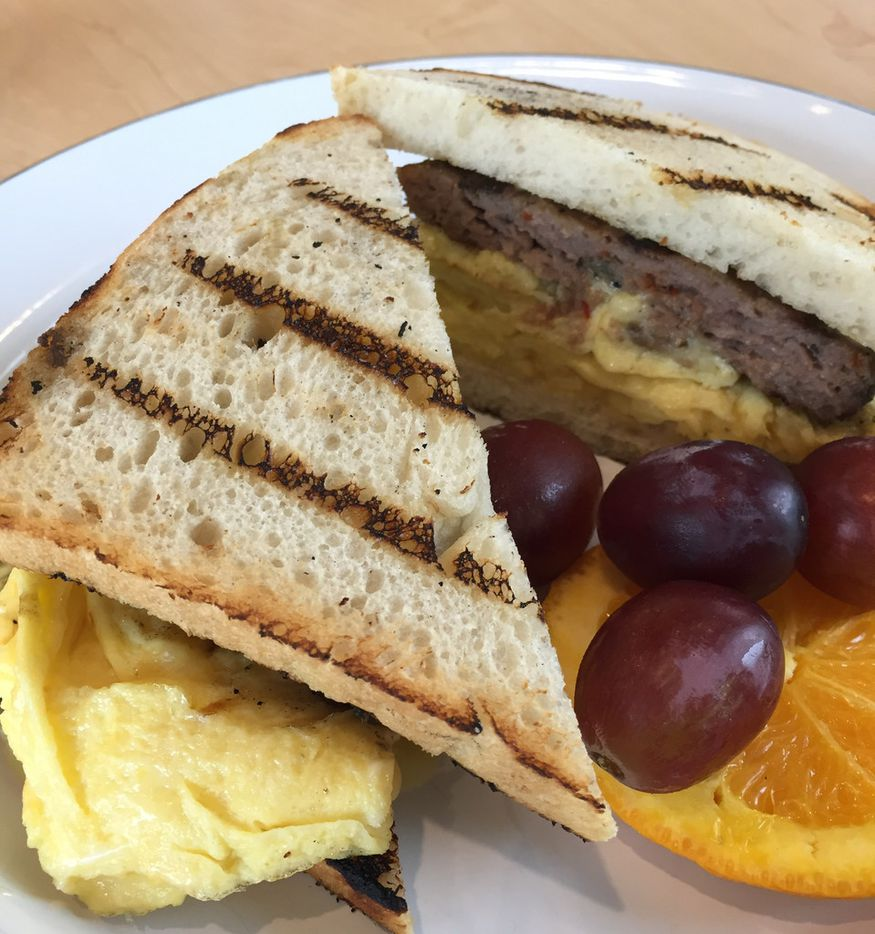 The Farmer's Breakfast Sandwich at The Market at Bonton Farms includes White Cheddar, Bonton Pork Sausage, farm fresh eggs and herbs in Dallas. (Irwin Thompson/The Dallas Morning News)