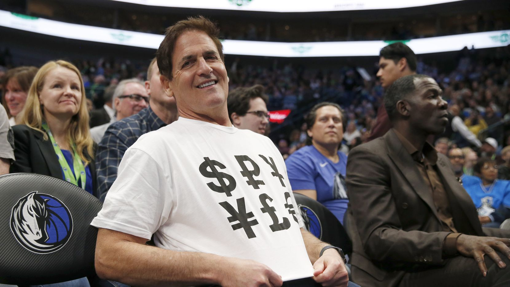 Dallas Mavericks owner Mark Cuban sports a shirt with money signs during the second half of play at American Airlines Center in Dallas on Friday, March 6, 2020. Dallas Mavericks defeated the Memphis Grizzlies 121-96.