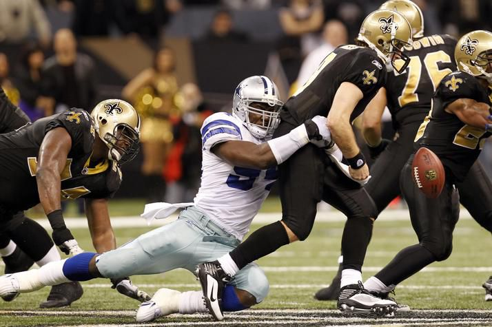 Cowboys linebacker DeMarcus Ware (94) causes Drew Brees (9) to fumble to end the Saints' last chance to tie the score.