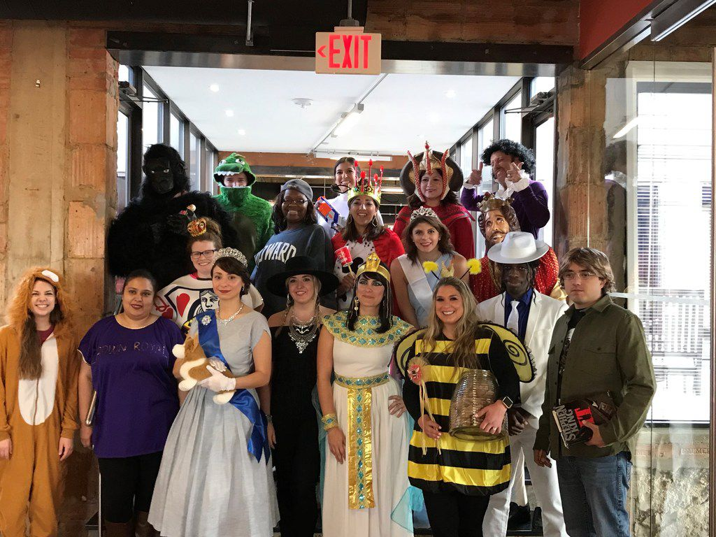 Ambit Energy workers show off their Halloween costumes.