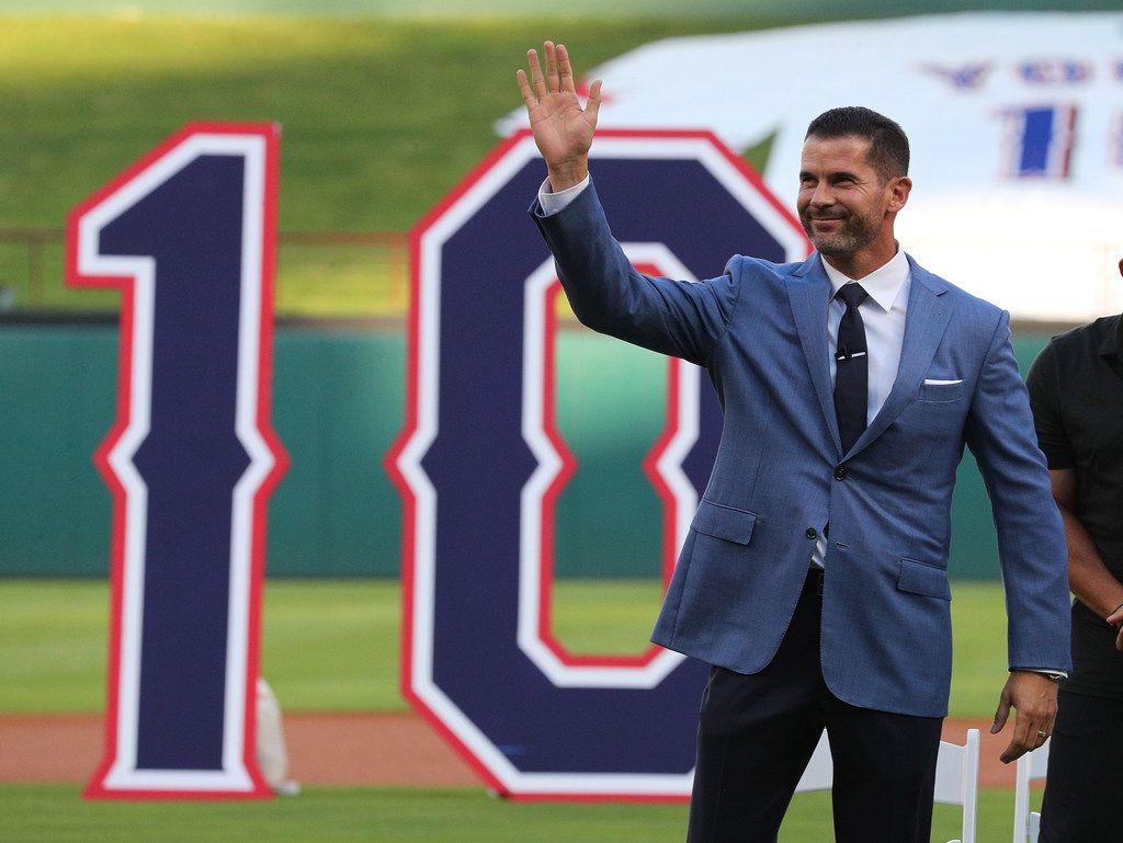 ARLINGTON, TEXAS - AUGUST 31: Michael Young, former Texas Rangers player, waves to the crowd after his entrance toa ceremony to retire his jersey number before a game against the Seattle Mariners at Globe Life Park in Arlington on August 31, 2019 in Arlington, Texas. (Photo by Richard Rodriguez/Getty Images)