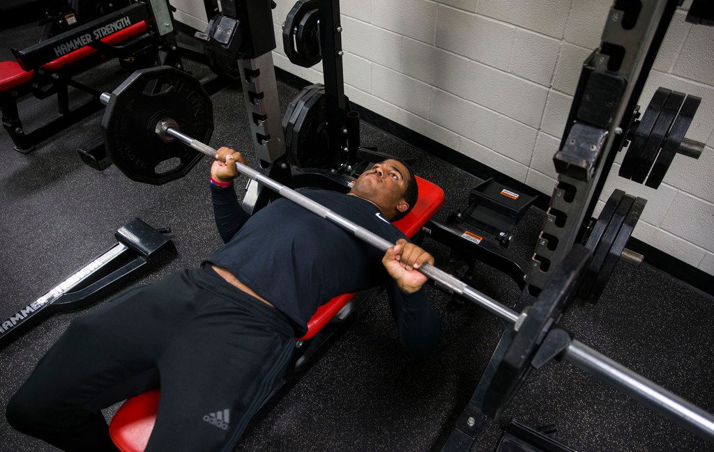 Mansfield Legacy football player Jalen Catalon works out in the weight room on Thursday, January 31, 2019 at Mansfield Legacy High School in Mansfield. Catalon's senior football season was ended by a torn left ACL. After surgery and months of rehab, he will sign to play football in the fall at University of Arkansas. (Ashley Landis/The Dallas Morning News)