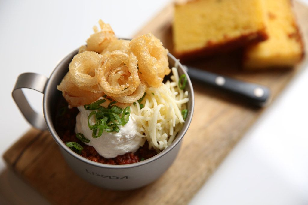 Chili with beer-battered pearl onions and cornbread photographed at Scout at The Statler Hotel in Dallas on Wednesday, Dec. 20, 2017. (Rose Baca/The Dallas Morning News)