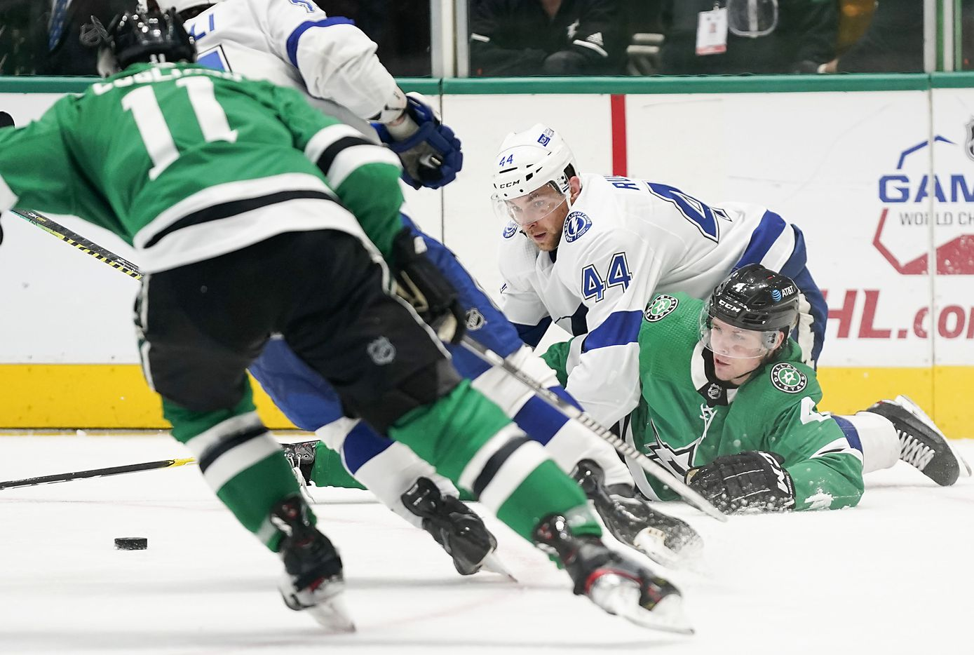 Dallas Stars defenseman Miro Heiskanen (4) fights for the puck with Tampa Bay Lightning defenseman Jan Rutta (44) during the third period of an NHL hockey game at the American Airlines Center on Thursday, March 25, 2021, in Dallas. The Stars won the game 4-3. (Smiley N. Pool/The Dallas Morning News)