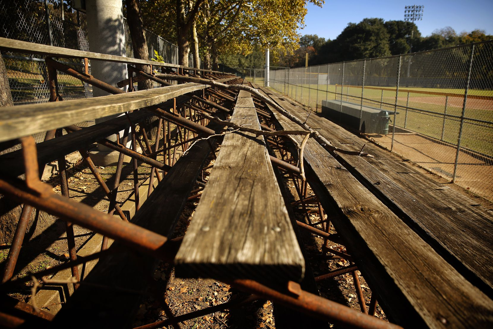 "The old first- and third-base wood-clad bleachers at the Reverchon ball field are barricaded from public use for safety reasons. Sam Carpenter, who played and coached there for years beginning in the late 1950s, says, ""Reverchon was where you wanted to play. It had history and it had teams that might have as many as five ex-pro players."""