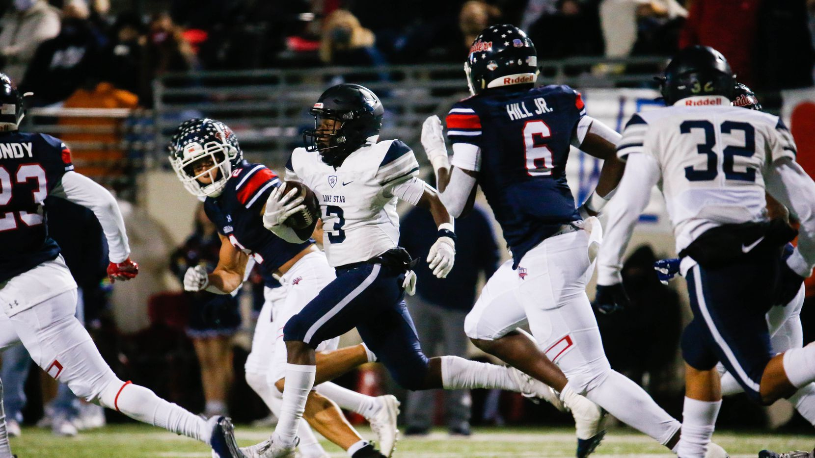 Frisco Lone Star's Tolu Sokoya (3) runs the ball during the first half of a football game against Denton Ryan at the C.H. Collins Complex in Denton on Thursday, Dec. 4, 2020.