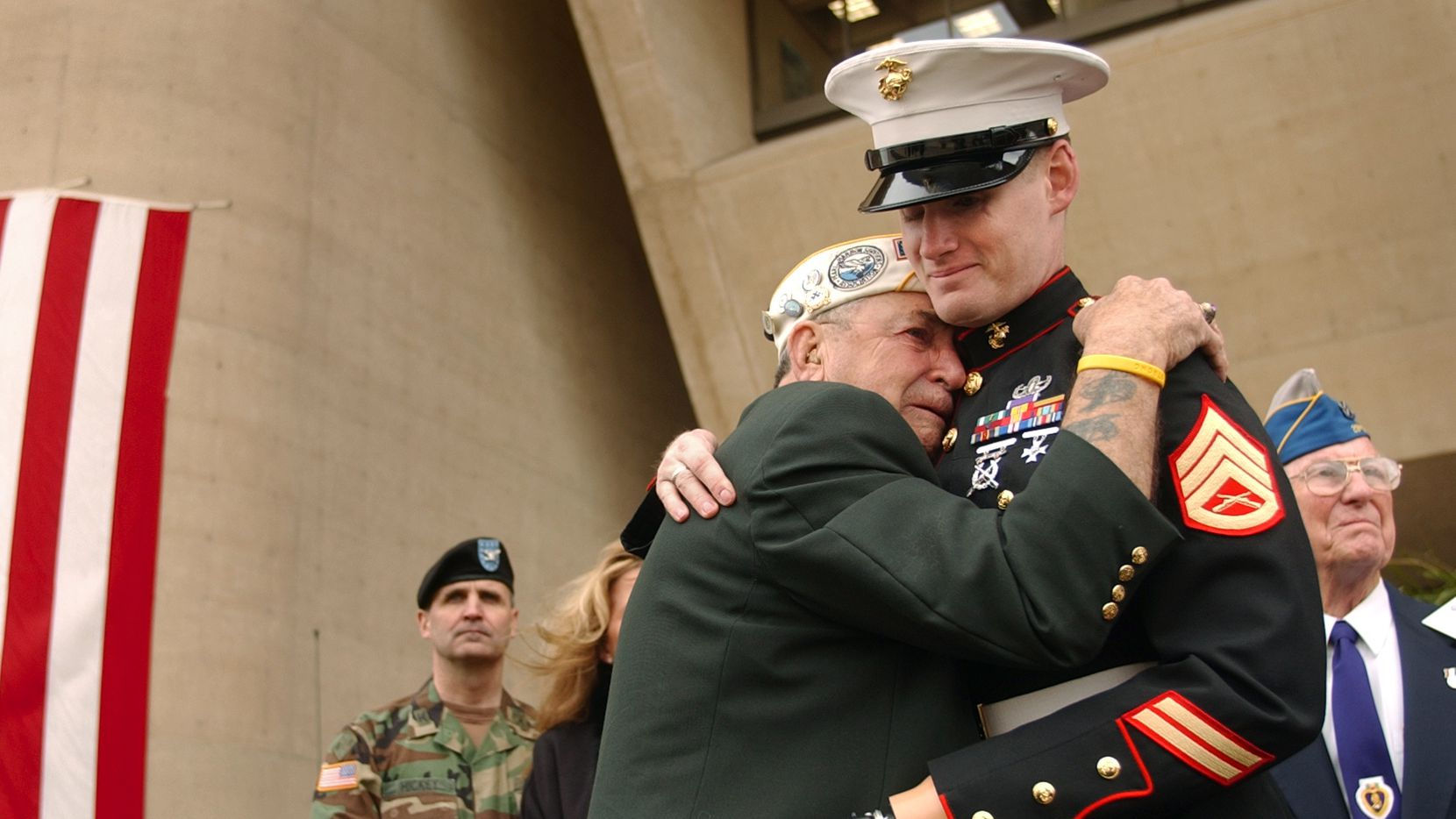 Pearl Harbor survivor Houston James of Dallas was overcome with emotion as he embraced former Marine Sgt. Mark Graunke Jr. of Flower Mound during the 2004 Dallas Veterans Day Commemoration. Photographer Jim Mahoney said it was one of his favorite images from his 32-year career at The Dallas Morning News.