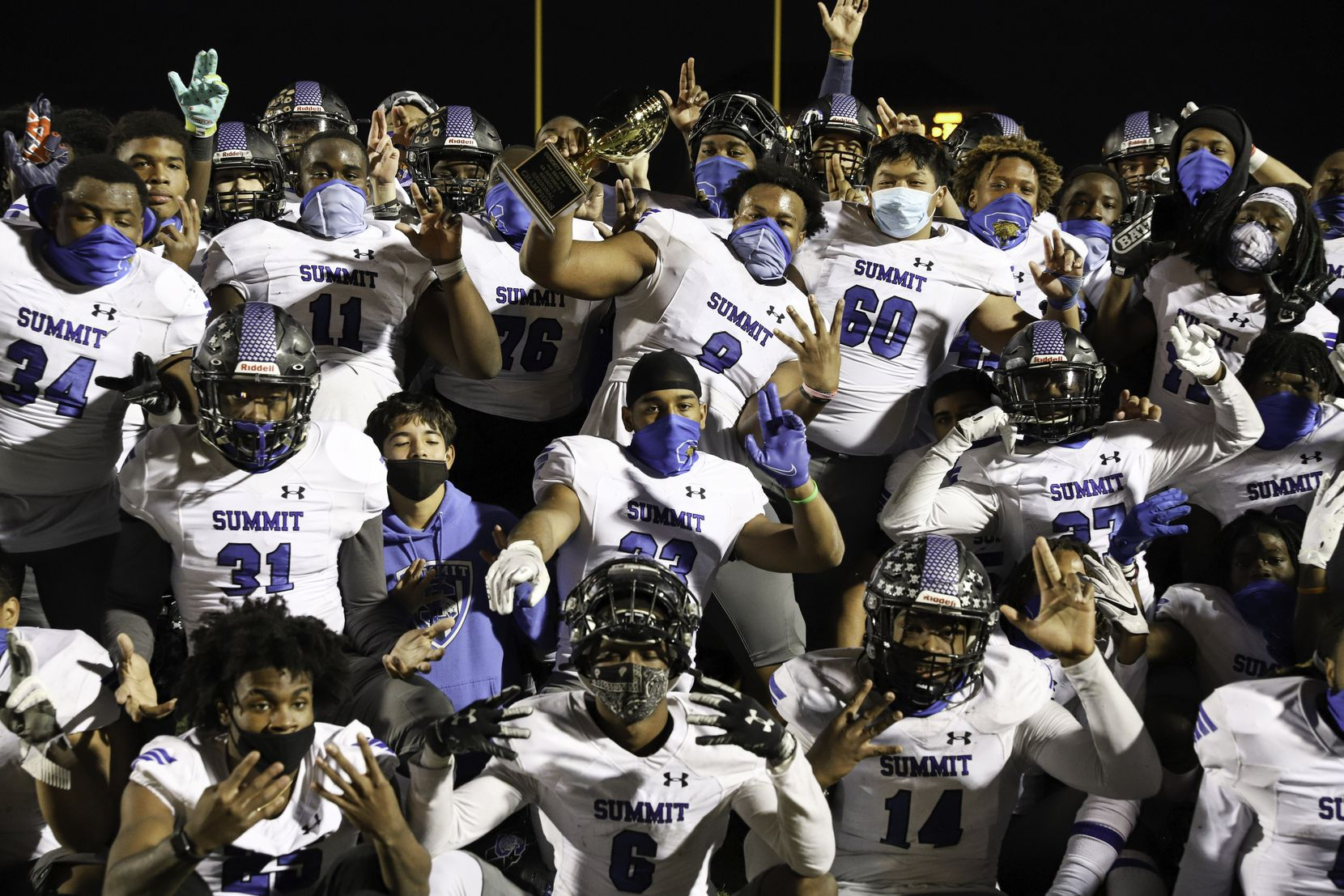 The Mansfield Summit football team poses with the regional championship trophy after defeating Colleyville Heritage at Bearcat Stadium in Aledo, Texas, Saturday, December 26, 2020. (Elias Valverde II / Special Contributor)