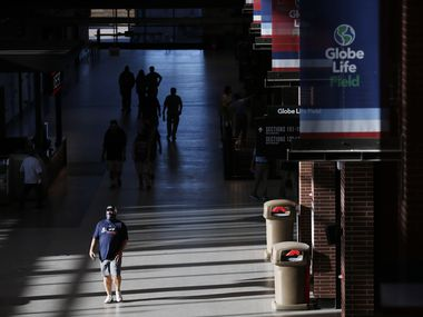 An Atlanta Braves fan walks through the concourse prior to the start of the National League Championship Series between the Atlanta Braves and the Los Angeles Dodgers  at Globe Life Field on Monday, October 12, 2020 in Arlington, Texas. This is the first time fans have been allowed into the stadium to watch a baseball game.