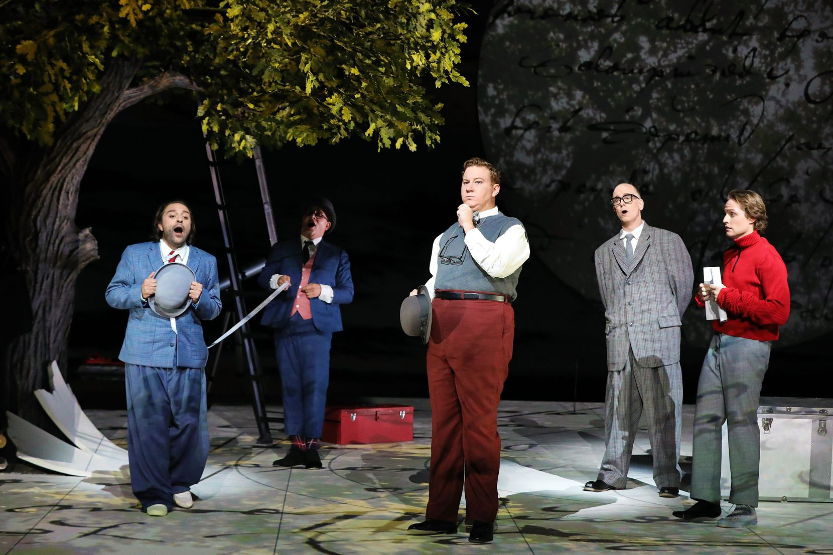 """Matthew Grills (Snout), Patrick Carfizzi (Starveling), Nicholas Brownlee (Bottom), Kevin Burdette (Quince) and Brenton Ryan (Flute) in 2021 Santa Fe Opera production of Britten's """"A Midsummer Night's Dream."""" Photograph by Curtis Brown/Santa Fe Opera."""