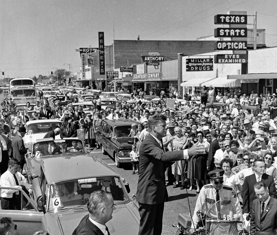 John F. Kennedy stands on the trunk of a car to deliver a speech in front of Millar Drugs in downtown Grand Prairie on Sept. 13, 1960.